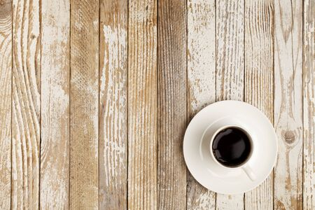 espresso coffee in a white china cup over grange wood surface with paint peeling off Stock Photo - 9283782