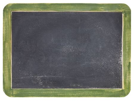 old blank slate blackboard with white chalk dust and texture, green wood frame photo