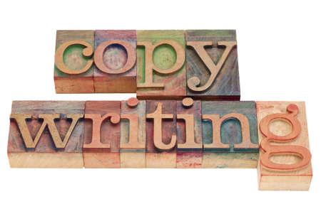 copywriting: copywriting word in vintage wood letterpress printing blocks, isolated on white