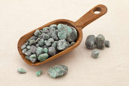 beryl: rustic scoop of raw emerald gemstones (mineral beryl)  with inclusions mined in Brazil