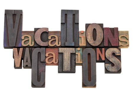 vacations word abstract in antique letterpress printing blocks of different size and style Stock Photo - 9378342