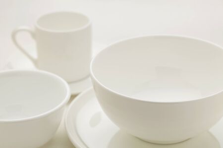 white china bowls and coffee cup, selective focus abstract Stock Photo - 9387539
