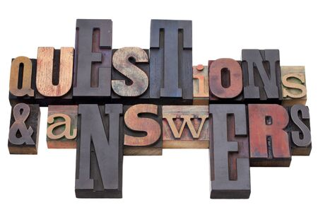 questions and answers - word abstract in antique wood letterpress printing blocks, isolated on white Stock Photo - 9417924