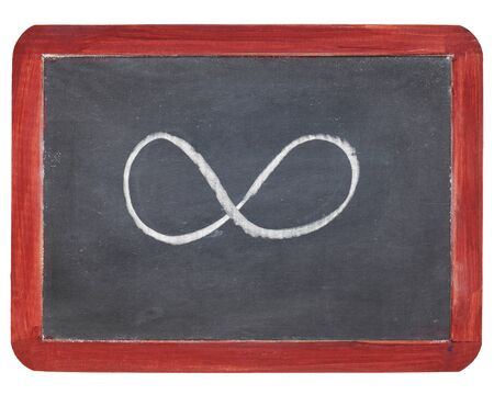 infinity symbol - white chalk  on small slate blackboard, isolated on white Stock Photo - 9441815