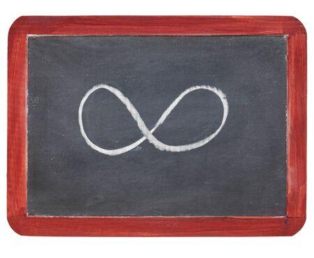infinity symbol - white chalk  on small slate blackboard, isolated on white Stock Photo - 9441815