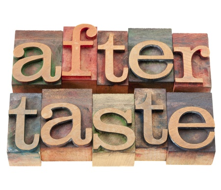 aftertaste: aftertaste - isolated word in vintage wood letterpress printing blocks Stock Photo