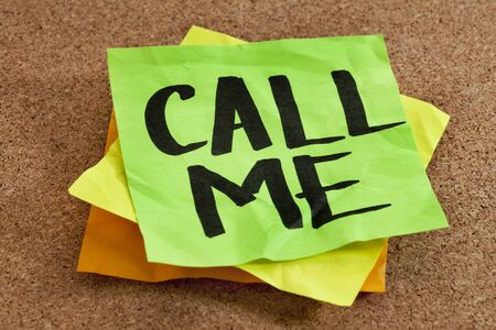 call me on sticky note posted on a cork board Stock Photo - 9467413