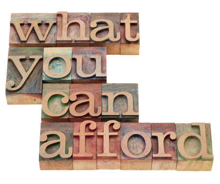 afford: what you can afford  - isolated phrase in vintage wood letterpress printing blocks