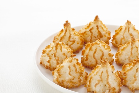 macaroon: coconut macaroon cookies on white plate against tablecloth