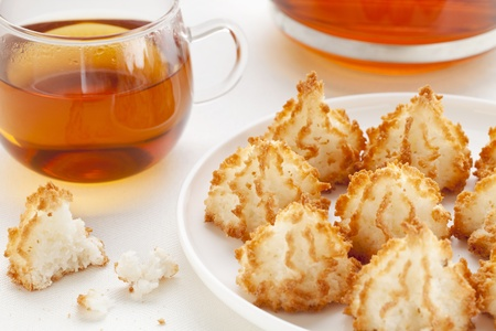 plate of coconut macaroon cookies and cup of tea