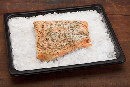 fillet of Norwegian salmon seasoned with lemon juice and thyme, freshly baked on rock salt Stock Photo - 9503946