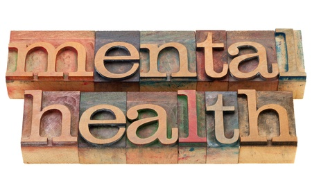 mental illness: mental health - isolated text in vintage wood letterpress printing blocks Stock Photo