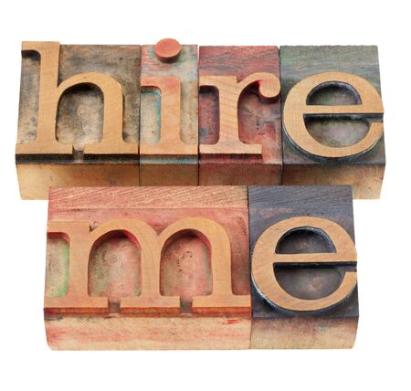 hire me - isolated phrase in vintage wood letterpress printing blocks Stock Photo - 9565976