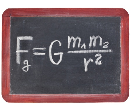 physics education concept - Newton gravity law on a small slate blackboard Imagens