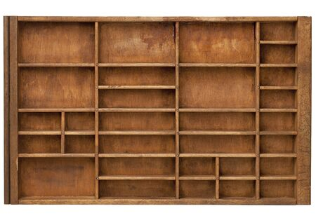 vintage wood  printer  (typesetter) drawer with numerous dividers, isolated on white Stock Photo - 9565977