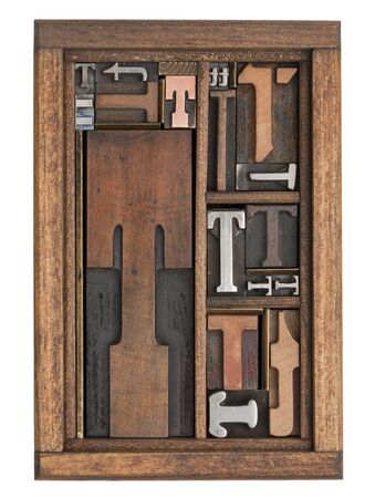 letterpress type: letter T abstract - vintage letterpress printing blocks of different size and style in a wooden box with dividers