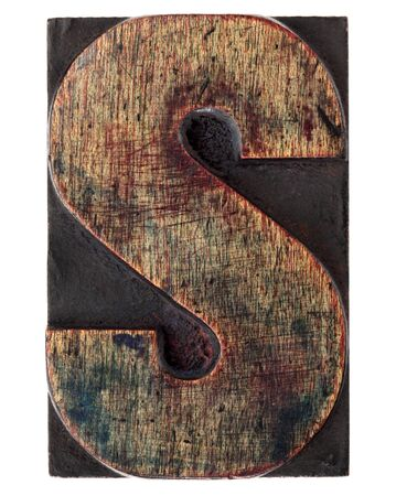 printing block: letter S - vintage wood letterpress printing block, scratched, stained by ink, isolated on white