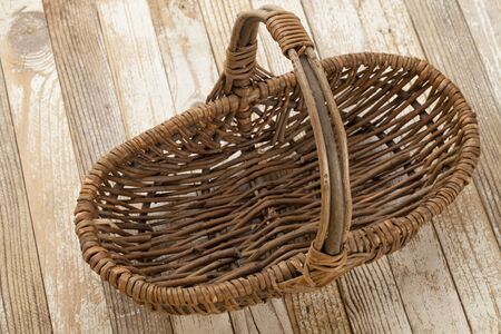 empty wicker basket on grunge white painted wood background Stock Photo - 9614091