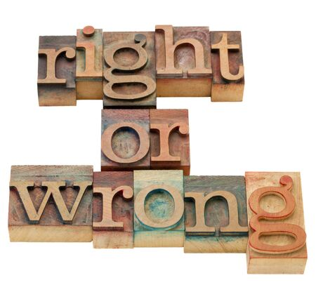 ethical: right or wrong ethical choice  dilemma - isolated vintage wood letterpress printing blocks