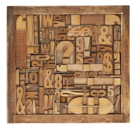 box of vintage wood printing blocks - letters, numbers, symbols, punctuation marks, brass inserts