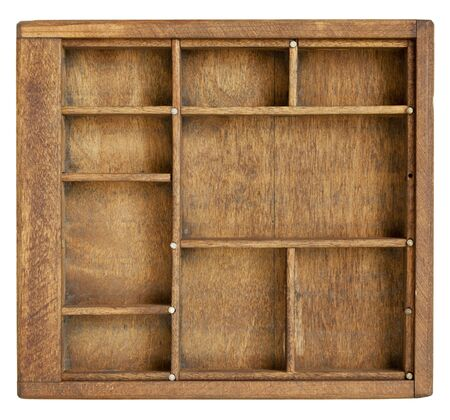 small vintage wood  case (typesetter drawer)  with  dividers, isolated on white Stock Photo - 9669343
