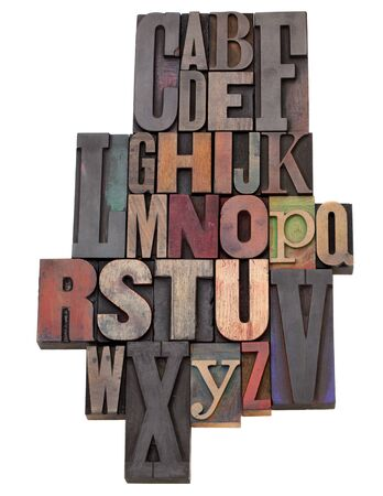 English alphabet abstract  in antique wood letterpress printing blocks of different size and style, isolated on white 版權商用圖片