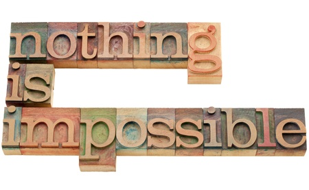 nothing: nothing is impossible - motivation concept - isolated text in vintage wood letterpress printing blocks