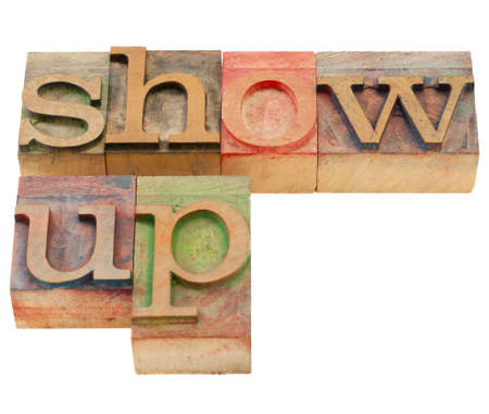 show up - motivation concept - isolated text in vintage wood letterpress printing blocks Stock Photo - 9669345