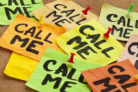 call me - several sticky notes on cork bulletin board with a reminder photo
