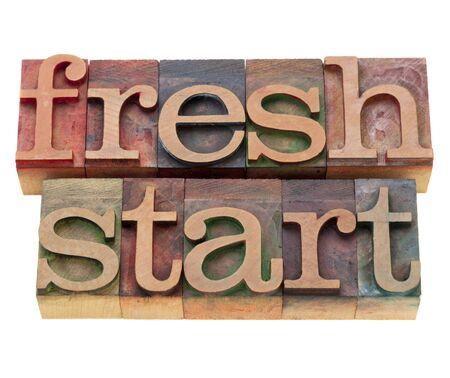 new start: fresh start - isolated words in vintage wood letterpress printing blocks