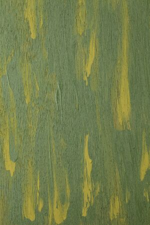 green and yellow  abstract with wood texture - acrylic paint on rough and grunge plywood