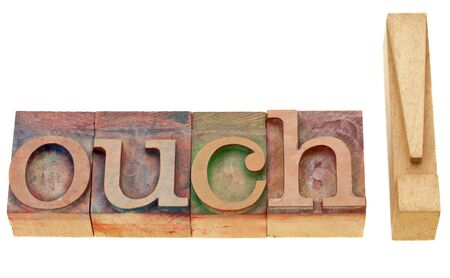 ouch: ouch - isolated exclamation word in vintage wood letterpress printing blocks