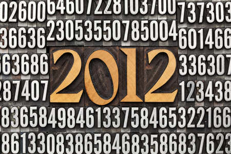 2012 number in vintage wood letterpress priniting blocks surrounded by random metal numbers photo