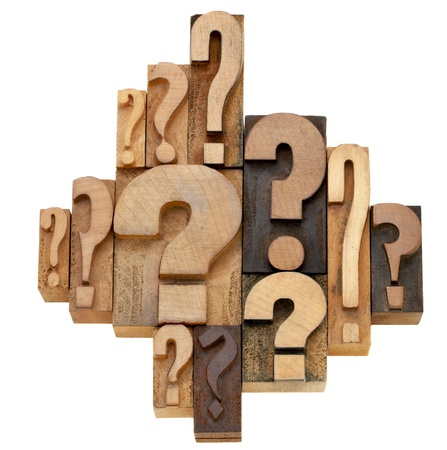 wood block: decision making or brainstorming concept - a collection of question marks - vintage wood letterpress printing blocks