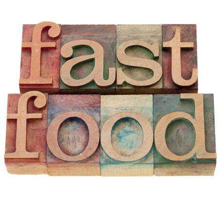 letterpress letters: fast food - isolated words in vintage wood letterpress printing blocks