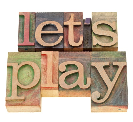 let us play - isolated words in vintage wood letterpress printing blocks Banco de Imagens