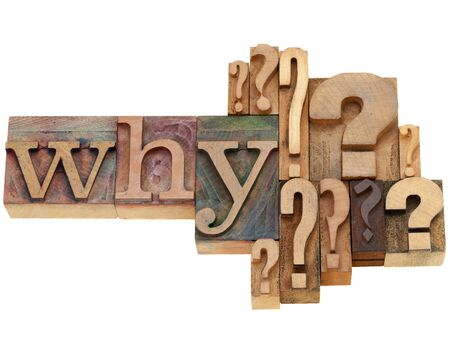 letterpress words: why question with multiple question marks - isolated vintage wood letterpress printing blocks Stock Photo