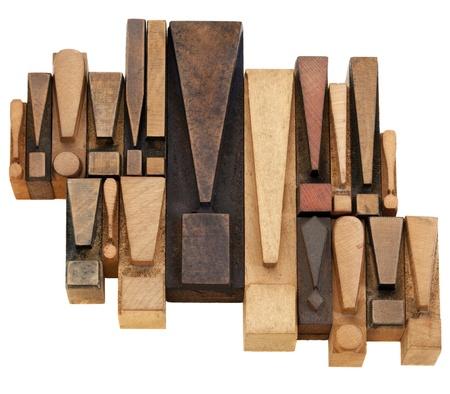 warning or alert  concept - a set of exclamation points - vintage wood letterpress printing blocks