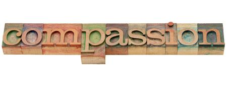printing block block: compassion  - isolated word in vintage wood letterpress printing blocks Stock Photo
