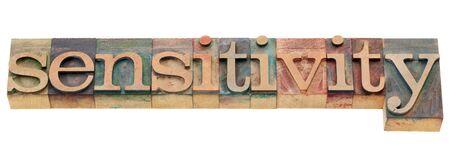 sensitivity: sensitivity - isolated word in vintage wood letterpress printing blocks
