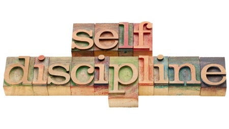 self discipline - isolated text in vintage wood letterpress printing blcoks Imagens - 10051544