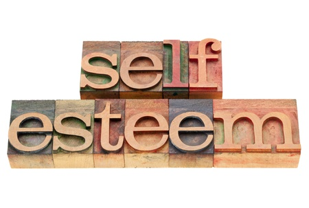 self confidence: self esteem - isolated text in vintage wood letterpress printing blocks