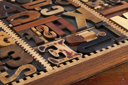 a variety of antique wood letterpress printing blocks in vintage typesetter box Stock Photo - 10127840