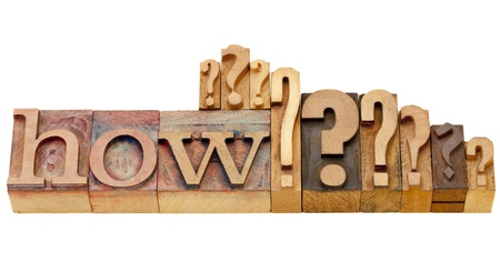 how: how question - isolated vintage wood letterpress printing blocks with multiple question marks