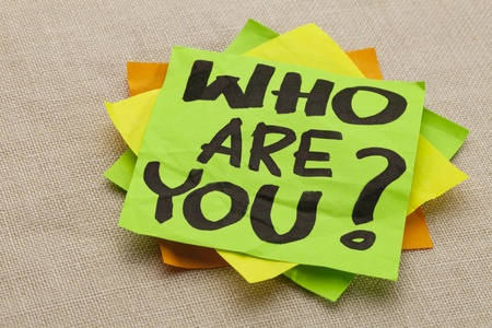 Who are you question - handwriting on a green sticky note Standard-Bild