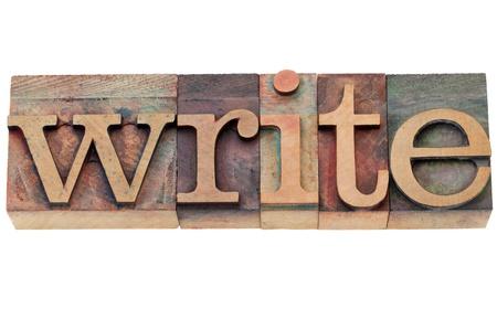 schrijven - geïsoleerde woord in vintage houten boekdruk blokken
