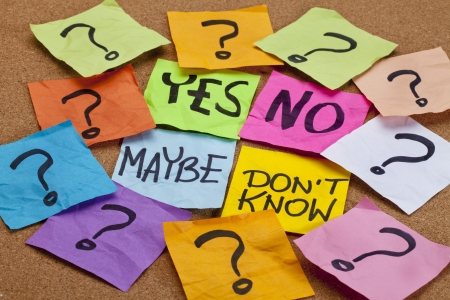 maybe: yes, no, maybe, I do not know - choice or uncertainty concept - colorful sticky notes on a cork bulletin board