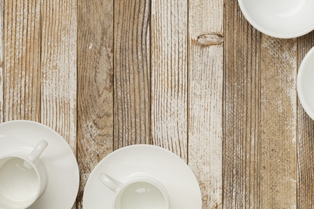 white china espresso coffee cups and other dishware on grunge white painted wood table Stock Photo - 10340918