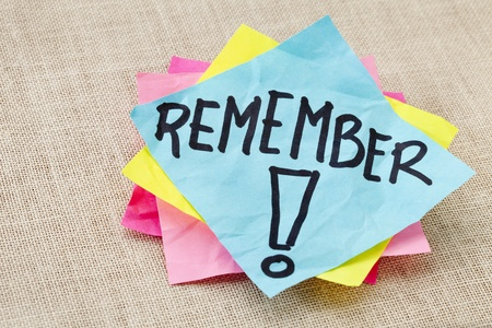 note of exclamation: reminder concept - remember word handwritten on blue sticky note