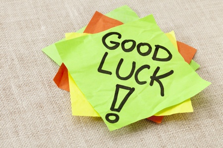 Good luck - black handwriting on green sticky note against canvas Stock Photo - 10412963